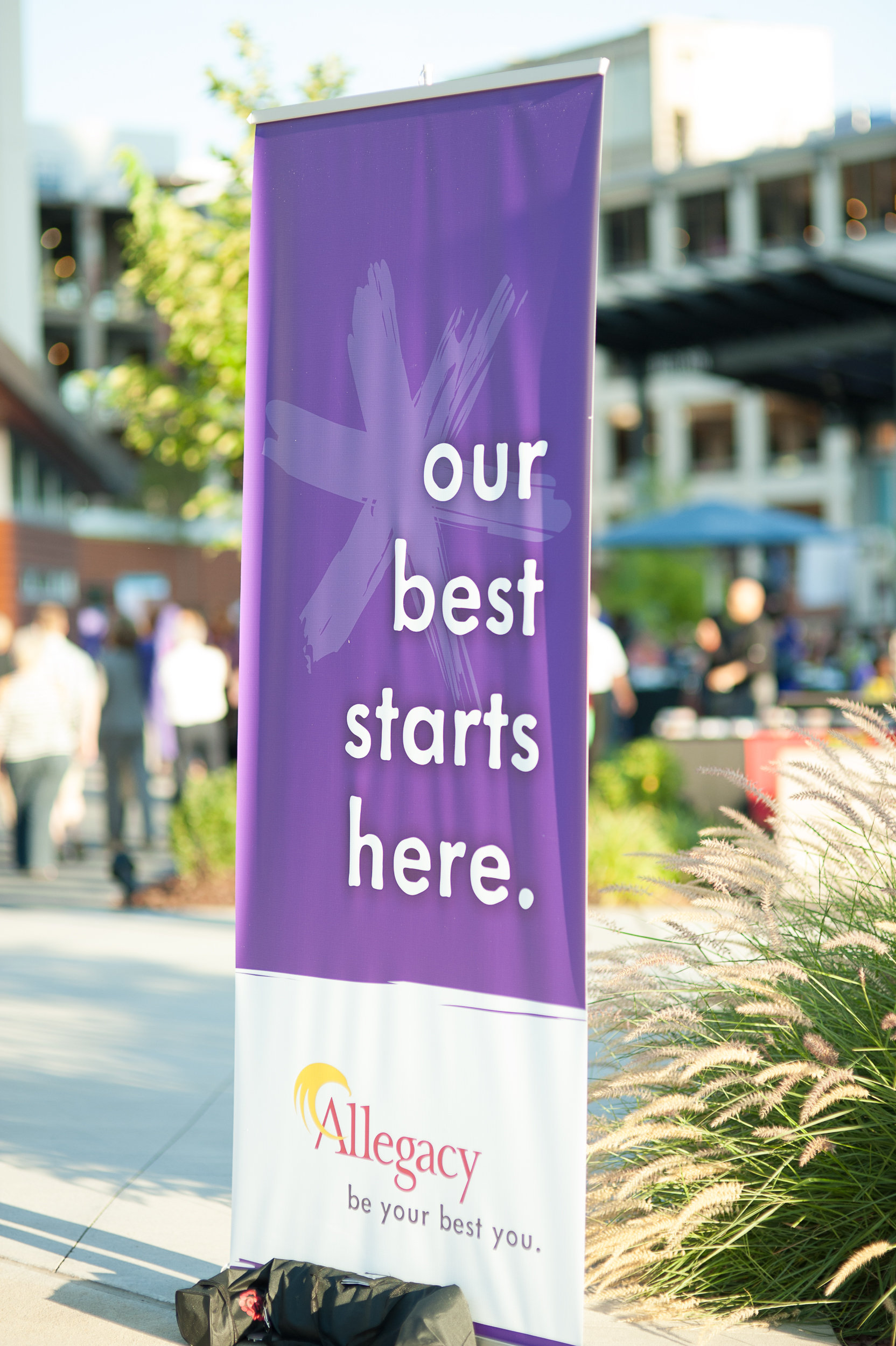 Pop Up Banner at All Staff Event: Our Best Starts Here